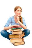 Esmer bir kitap yığını ile konuyu öğrenmek için — Stok fotoğraf