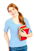 Beautiful student with books smiling — Stok fotoğraf