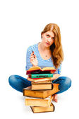 Tortured girl with books makes lessons — Stock Photo
