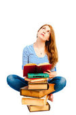 Thoughtful student and pile of books — Stock Photo