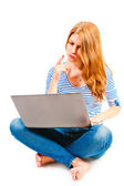 Woman with laptop sitting on a white background — Stock Photo