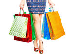 Shapely female legs closeup and purchase — Stock Photo
