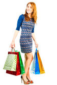 Shopaholic girl with purchases from shop — Photo