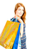 Studio shot of a beautiful girl shopaholic — Stock Photo