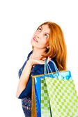 Shopaholic dreams of purchases on a white background — Stock Photo