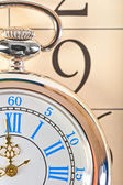 Part of a pocket watch lying on the calendar — Stock Photo