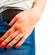 Closeup pocket of jeans and a female hand — Stok fotoğraf #44698443