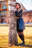 Girl in coat in autumn birch Russian — Stock Photo