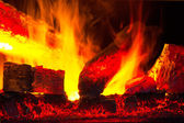 Burning down fire logs in macro photography — Stock Photo