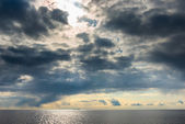 Dark cumulus clouds hovering over the sea — Stock Photo