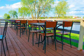 Empty tables in a cafe by the river — ストック写真