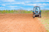 Tractor plowed field in spring — Stock Photo