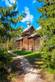 Old wooden church of the firs — Stock Photo