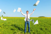 Successful businessman threw papers in the field — Stock Photo