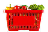 Red plastic basket full of healthy vitamins — Stock Photo