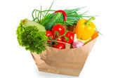 Paper bag brim full of healthy dietary food — Stock Photo