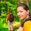 Hiking in summer forest with good cheer — Stock Photo