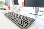 Modern Computer on the desktop in the office building — Stock Photo