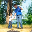 Father and son put a tent in the camping — Stock Photo #50185391