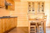 Empty kitchen in a wooden farmhouse — Stock Photo