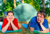 Man and woman lying in camping resting — Stock Photo