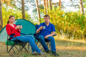 Spouses drinking tea in the morning in a camp — Stock Photo