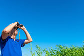Looking for something in the blue sky — Stock Photo