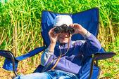 Little boy looking through binoculars — Stock Photo