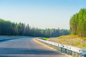 New empty road with no line marking — Stock Photo