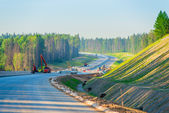Construction of a new highway, shot in the early morning — Stock Photo