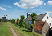 Church and windmill — Stock Photo