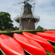 Canoes with Mill — Stock Photo