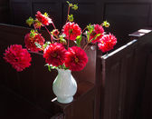 Vase with dahlia in church — Stock Photo