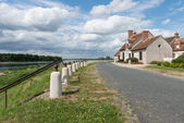 Dike and road — Stock Photo