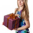 Young Woman holding a gift isolated on a white background — Stock Photo #10964448