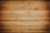 Bamboo sticks wooden background — Stock Photo
