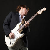 Handsome young man with electric guitar — Stock Photo