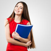 Beautiful business woman holding folder — Stock Photo