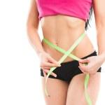 Woman measuring her waistline — Stock Photo #23672147