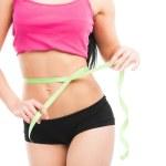Woman measuring her waistline — Stock Photo #23674259