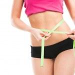 Woman measuring her waistline — Stock Photo