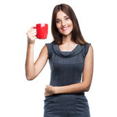 Beautiful young woman with red cup — Stock Photo
