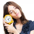 Beautiful woman with yellow alarm clock — Stockfoto