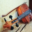 Vintage violin on empty  wall - Stock Photo
