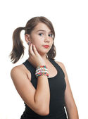 Beautiful teen girl in black top with pigtails — Stock Photo