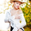 Sexy portrait woman with hat and white shirt in the autumn day — Stock Photo