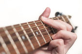 Close up of guitarist hand playing acoustic guitar — Stock Photo