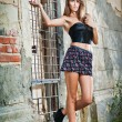 Sexy girl posing fashion near red brick wall on the street.Tall young woman posing outdoo — Stock Photo