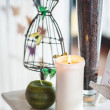 Composition with ornament, candle and butterfly - Stock Photo