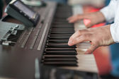 Musician playing on keyboards. — Stock Photo